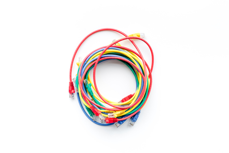 Colored patch-cord in round shape on white background top view