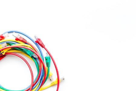 Colored patch-cord on white background top view copyspace
