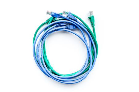 Cables for computer on white background top view.