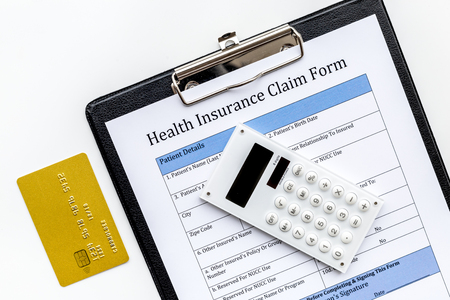Buy health insurance. Document, bank card and calculator on white background top view. Stock Photo