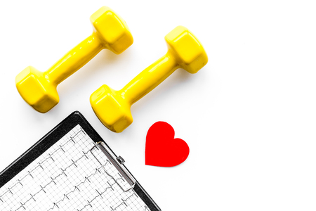 Prevent heart disease. Heart sign, cardiogram and dumbbells on white background top view copyspace Stock Photo
