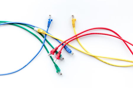 Colored patch-cord on white background top view Stock Photo