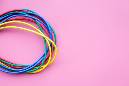 Network colored cables for computer on pink background top view copyspace Stock Photo