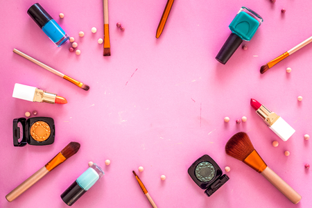 Set of decorative cosmetics. Lipstick, eye shadows, nail polish, rouge, brushes for makeup on pink background top view copyspace Stock fotó