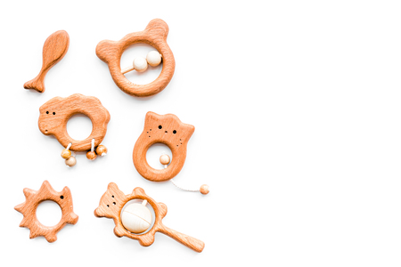 Cute wooden handmade toys for newborn on white background top view copyspace Imagens