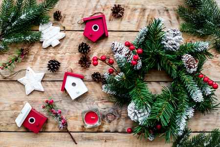 Decorate house for Christmas. Wreath and toys on light wooden background top view Stock Photo