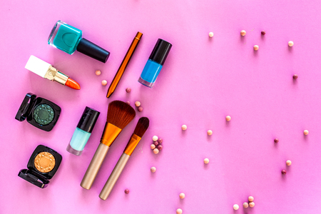 Set of decorative cosmetics. Lipstick, eye shadows, nail polish, rouge, brushes for makeup on pink background top view Фото со стока - 90304532