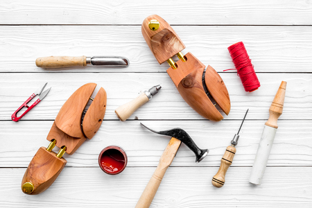 Shoe repair. Tools on white wooden background top view. Zdjęcie Seryjne