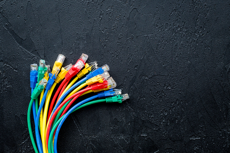 Network wires assorted colors with tips on black background top view.