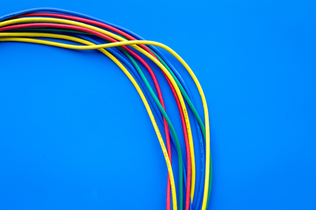 Network colored cables for computer on blue background top view. Stock Photo