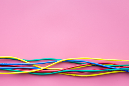 Network colored cables for computer on pink background top view. Stock Photo - 90405550