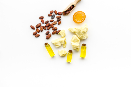 Cocoa butter for skin care. White background top view.