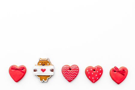 Sweets on Valentines Day. Cookies in shape of heart and with lettering I love you on white background top view.