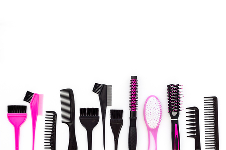 Hairdressing tools. Pattern with various combs and brushes on white background top view,
