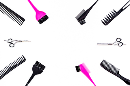 Beauty saloon equipment. Combs, sciccors, brushes on white background top view.