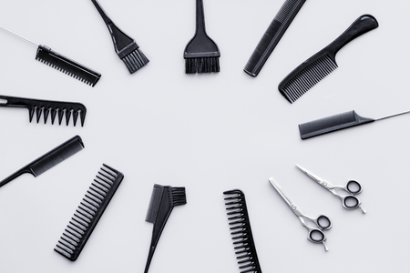 Beauty saloon equipment. Hairdress and haircut. Combs, sciccors, brushes on grey background top view. 写真素材