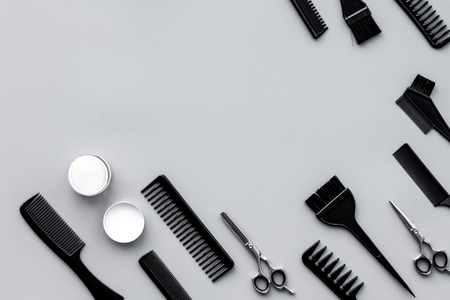 Beauty saloon equipment. Hairdress, haircut. Combs, sciccors, brushes on grey background top view copy space Stock Photo