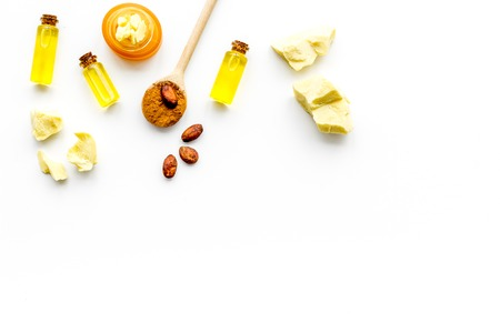 Cocoa butter as ingredient for natural cosmetics. White background top view.