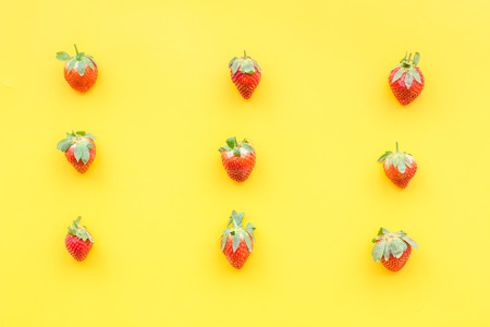 Fresh ripe strawberry. Pattern on yellow pastel background top view Stock Photo