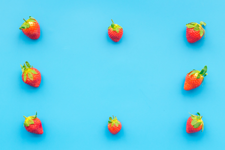 Fresh ripe strawberry. Pattern on blue pastel background top view copy space Stock Photo