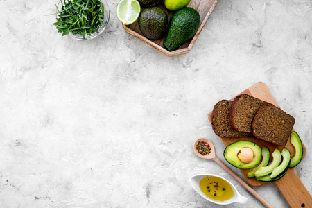Avocado toast for light healthy breakfast on grey background top view. Stock Photo