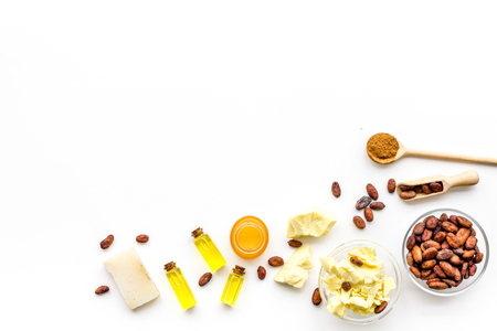 Cocoa butter for skin care. White background top view copy space