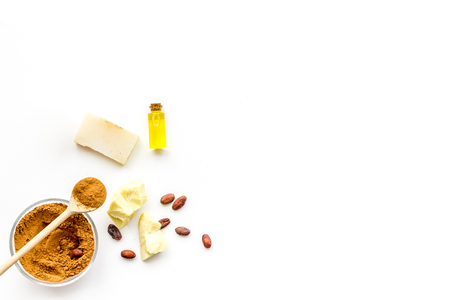 Cocoa butter as ingredient for natural cosmetics. White background top view copy space