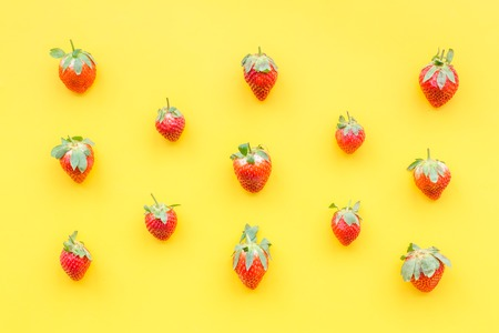 Fresh ripe strawberry. Pattern on yellow pastel background top view. Stock Photo