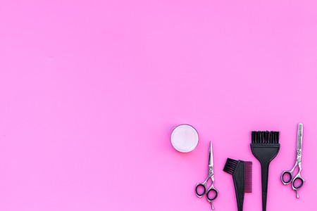 Professional hairdressing tools in beauty saloon on pink background top view. Stock Photo