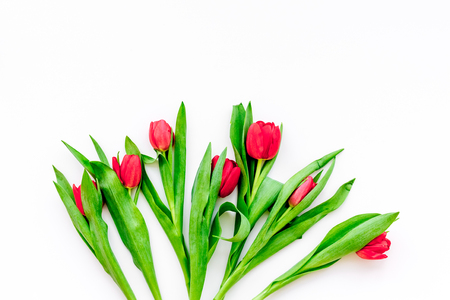 Bright red tulips for spring bouquet on white background top view. Banco de Imagens - 94568258