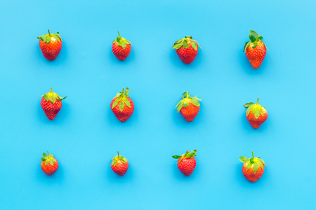 Fresh ripe strawberry. Pattern on blue pastel background top view