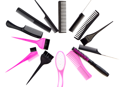 Hairdressing tools. Various combs and brushes on white background top view