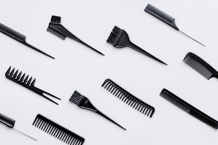 Hairdressing tools. Pattern with various combs and brushes on grey background top view. 写真素材