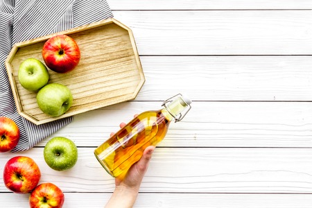 Homemade cider from ripe apples. White wooden background top view copy space