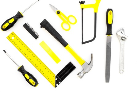 Repair tool kit. File, saw, hummer, corner ruler on white background top view pattern Stock Photo