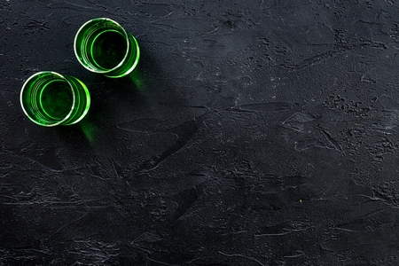 Absinthe shots on black background top view copy space Stock Photo