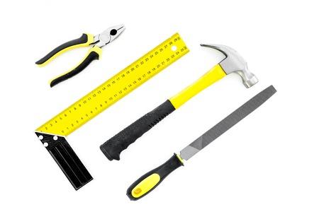 Repair tool kit. File, hummer, corner ruler on white background top view.