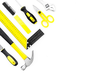 Repair tool kit. File, hummer, corner ruler on white background top view.