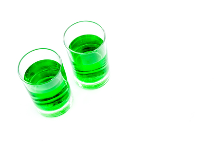 Absinthe shots on white background top view.
