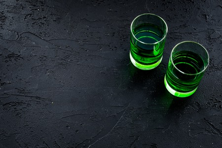 Absinthe shots on black background top view. Stock Photo