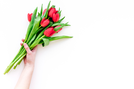 Bright red tulips for spring bouquet on white background top view. Banco de Imagens - 95030663