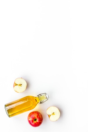 Homemade cider from ripe apples. White background top view. 版權商用圖片