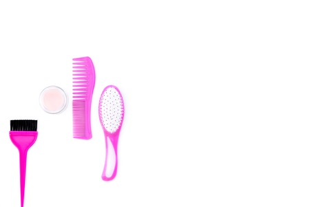 Professional hairdressing tools in beauty saloon. Combs, brushes on white background top view copy space Stock Photo
