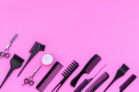 Beauty saloon equipment. Hairdress, haircut. Combs, sciccors, brushes on pink background top view copy space