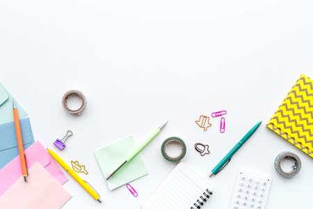 Scattered stationery on student's desk. White background top view. Standard-Bild