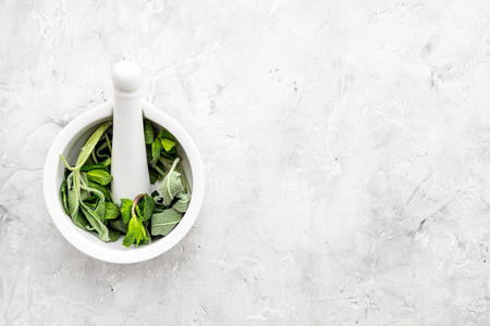Phytotherapy. Herbs in mortar bowl on white background top view. Banco de Imagens - 95278233