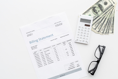 Pay bills and taxes. Billing statement, calculator, money on white background top view. Stockfoto