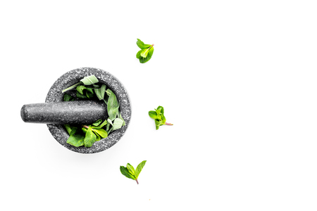 Phytotherapy. Herbs in mortar bowl on white background top view. Banco de Imagens - 95333431