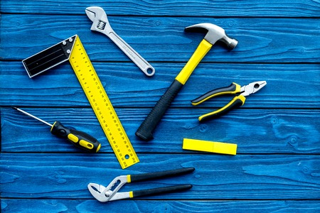 Repair tool kit background. Blue wooden table top view pattern.