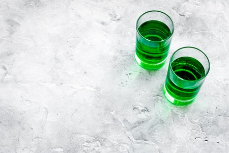 Absinthe shots on grey stone background top view. Stock Photo